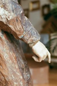 Santa Barbara statue before restoration